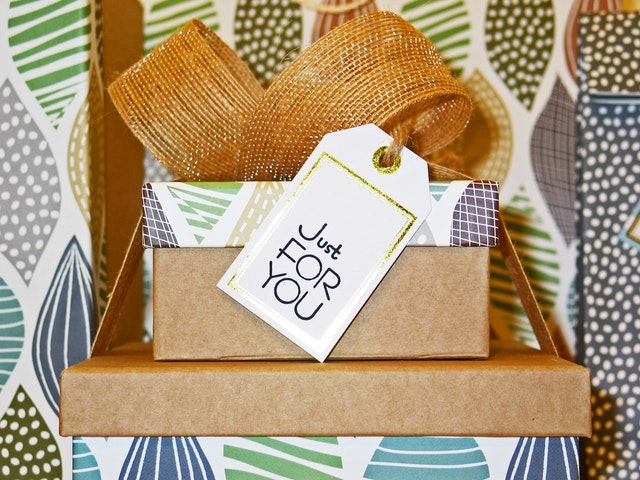 Colorful gift boxes with a note on them