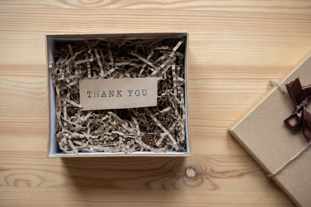 A gift box with a thank you note inside